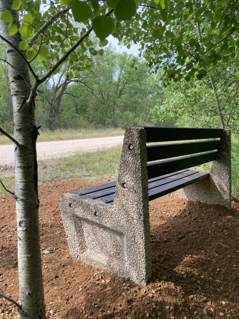 newly installed rest bench along the trail between town and the Miami Golf Club